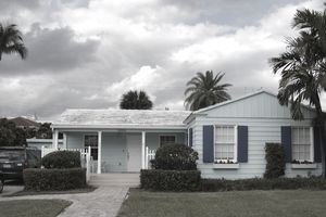 Blue ranch house with dark blue shutters in Florida