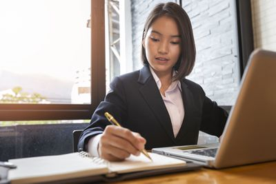 Young businesswoman using laptop computer