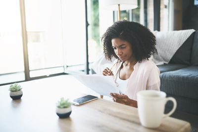 Woman looking at contract at home
