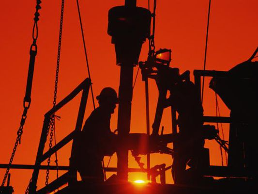 Oil drilling workers on rig in Houston, Texas