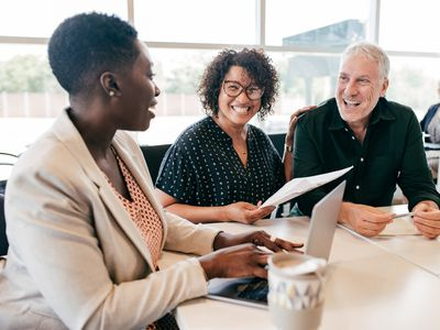 Man and woman meeting with a financial advisor for retirement planning