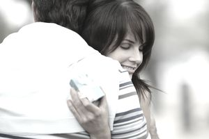Woman hugging a man after receiving a gift