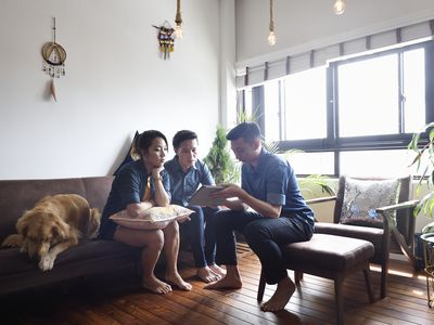 Couple signing paperwork to buy a house