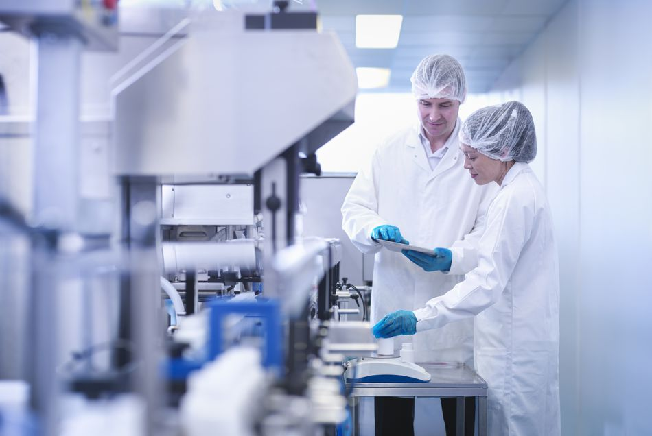 workers in a pharmaceutical lab