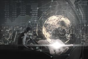 Double exposure of Businessman hand holding the particle earth with technology network circle over Asian businessman using laptop showing the Stock market chart over the cityscape