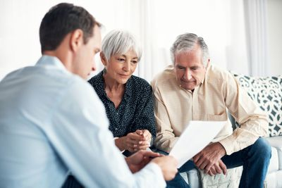 Couple discussing a living will with an estate attorney