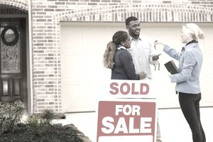 Couple receives keys to first home real estate purchase. - stock photo