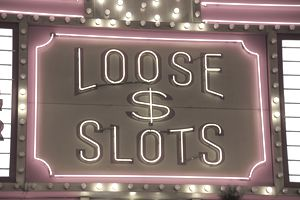Sign suggesting slot machines with high payout ratio in downtown area.