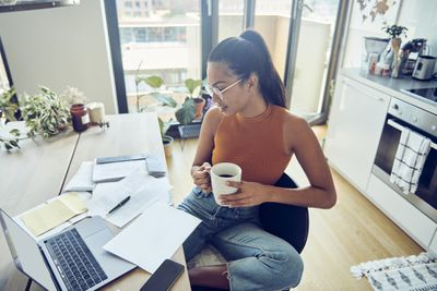 Business owner doing finances at home