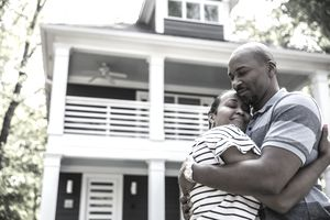 A couple of first-time homebuyers embrace outside their new house