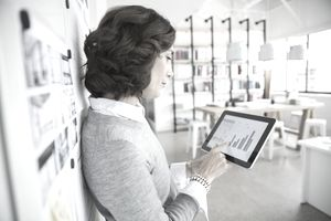 A woman evaluates her credit mix on a tablet computer.