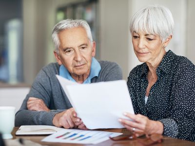 older couple Looking at their individual retirement accounts