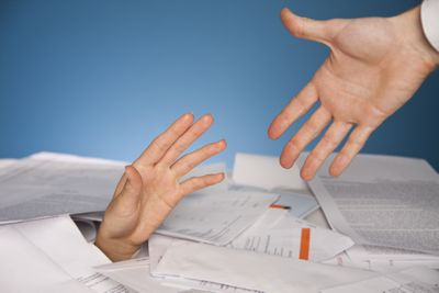 Financial help hands grabbing for one another