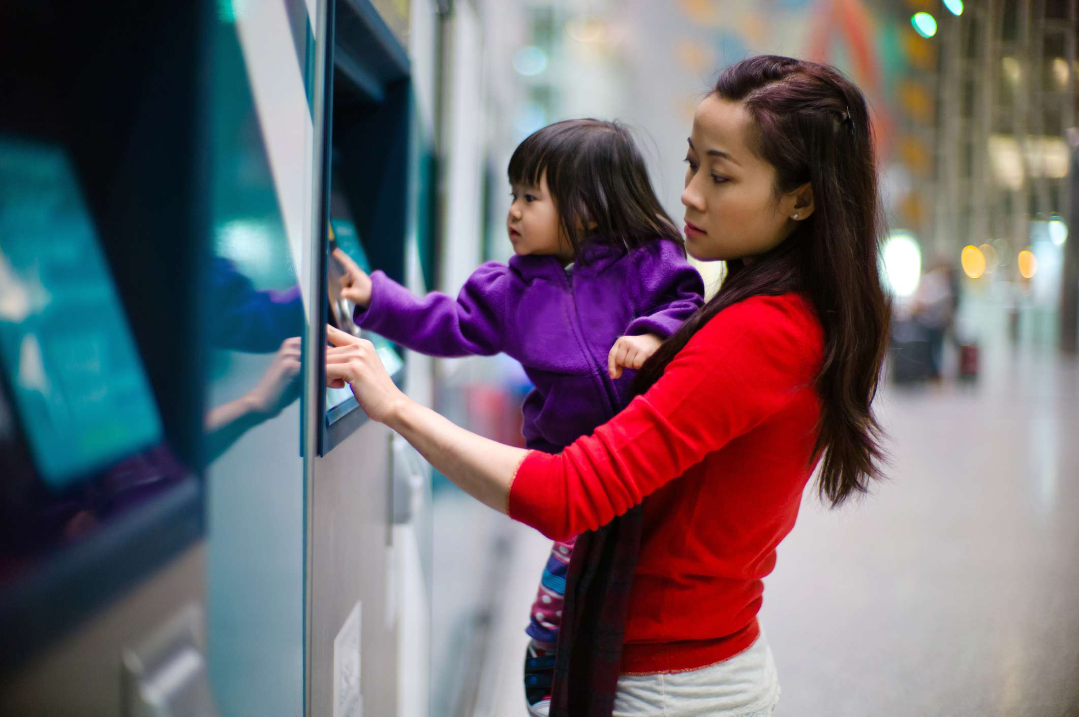 Woman and child at ATM