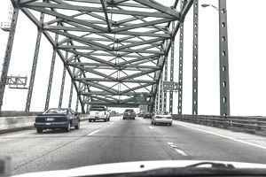 Cars on a bridge approaching the Maine state line