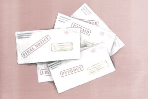 A stack of past due and overdue notices