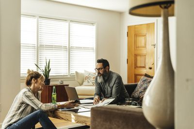 couple working from home in living room