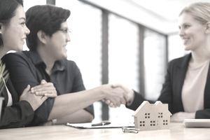 Couple entering into home buying agreement with lender