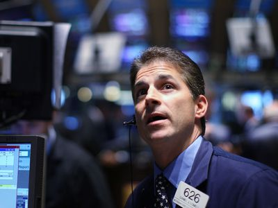 Trader working on floor of the NY Stock Exchange