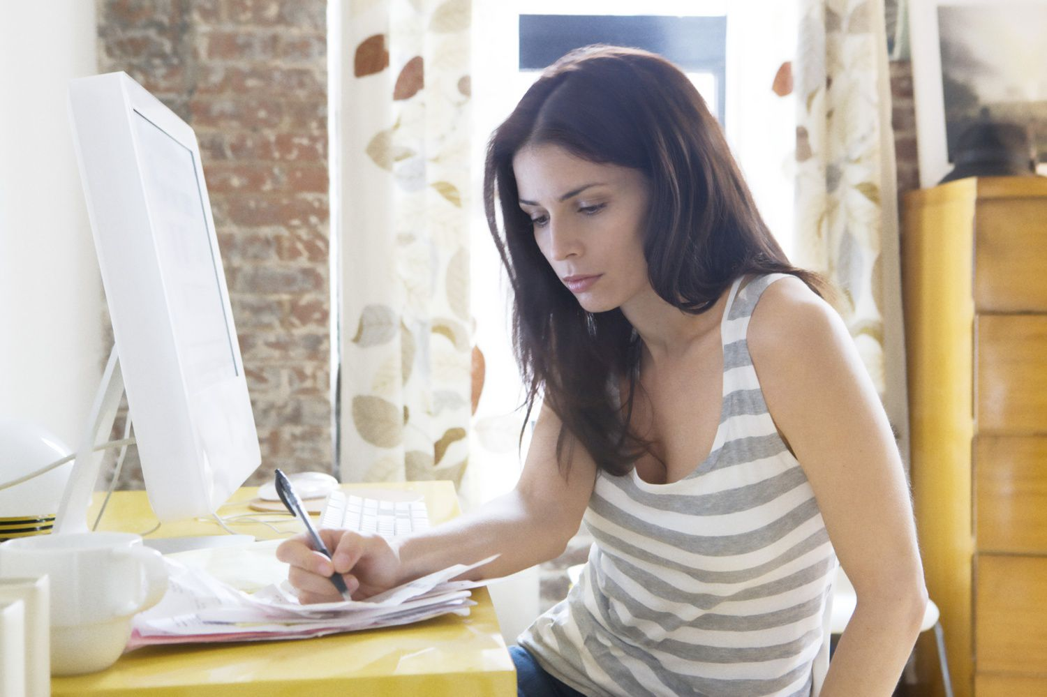 woman budgeting in home office to avoid overspending