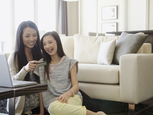 Mom and daughter with credit card