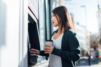 Woman getting money from an ATM