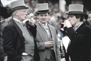 Aristocratic men in top hats sipping champagne