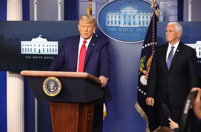 President Donald Trump delivers remarks as Vice President Mike Pence looks on.
