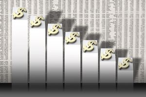 photo illustration of bar graph with dollar signs overshadowing the financial section of a newspaper