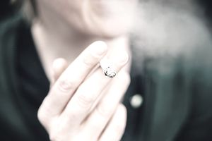Close up of cigarette in someone's hand