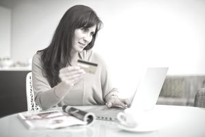 A credit card user checks her extended warranty feature.