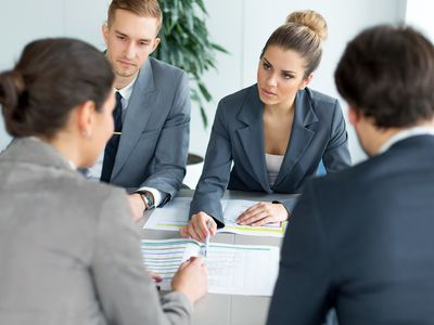 Four business people in an office meeting