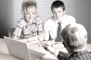 Two people meeting with an advisor