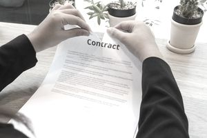 Man ripping contract at desk