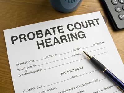 Closeup of probate court hearing notice and a pen