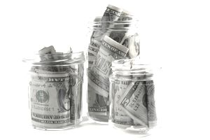Dollar bills squashed into three jars