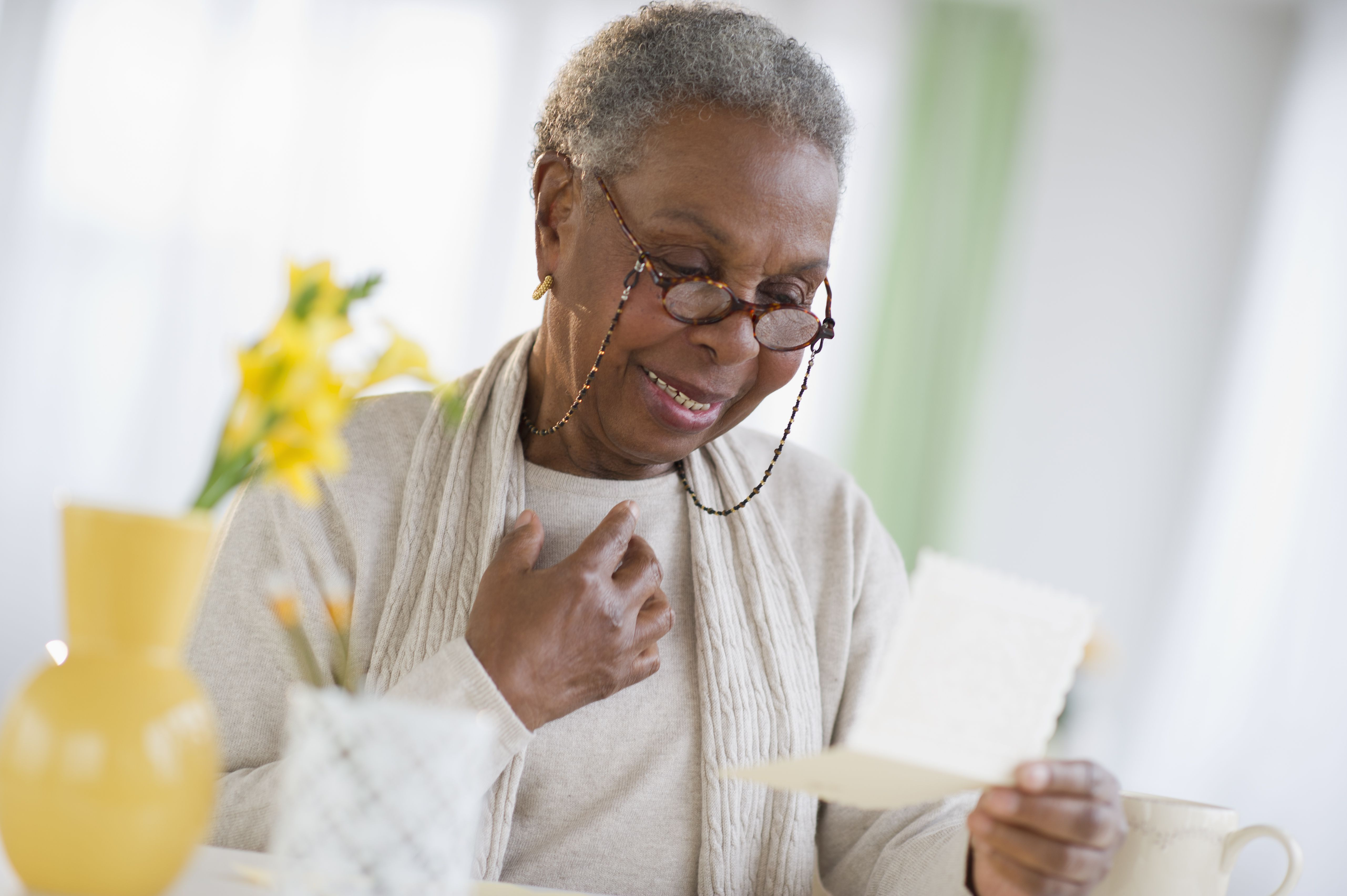 Elderly woman smiling as she receives news of a 529 Plan gift