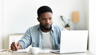 Man using laptop searching for vacancies online