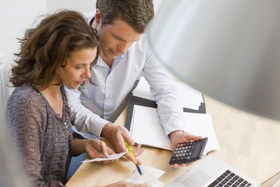 A young couple managing their budget