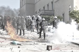 Riot police in Greece surrounded by flames and smoke