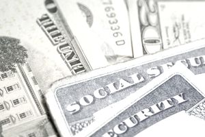 Social security cards on money