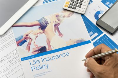 Life insurance brochure with family image and paperwork