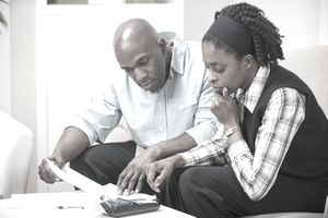 Couple working on their budget