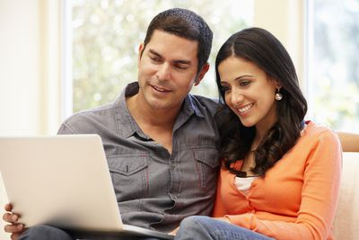 A happy couple reviews their credit report
