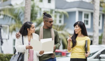 Realtor meeting with young African-American couple