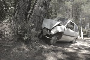 Crashed car in woodland