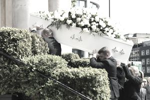 Carrying the casket