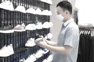 Man shops for sneakers at a mall