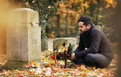 Man visiting grave site of a loved one who did not have a last will and testament in California