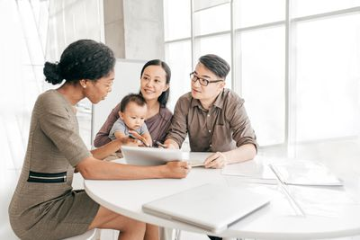 Family discussing retirement planning papers with a financial advisor